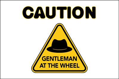Caution-Man-at-Wheel-400x