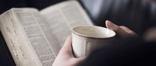 Bible and coffee cup