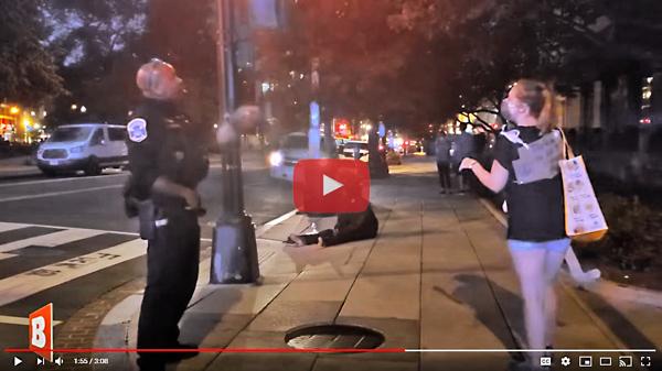 Black-office-witnesses-to-protester-adj2