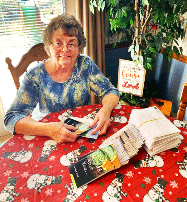 lady-at-table-with-booklets_2